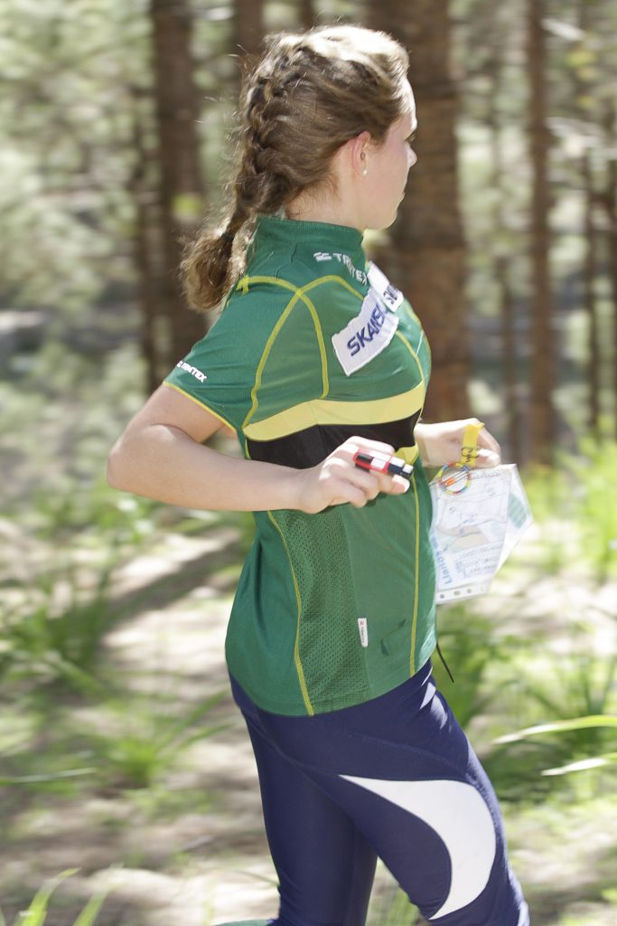 Young woman runnig in the pine forest at Gran Canaria GCOM